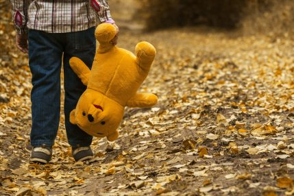 boy-carrying-bear-plush-toy-33159