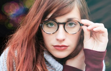 woman-with-brown-hair-wearing-eyeglasses-1112203